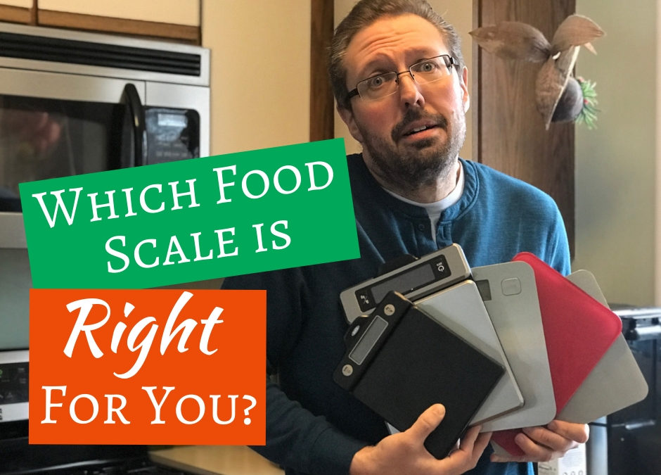 Author holding various Bright Line Eating food scales